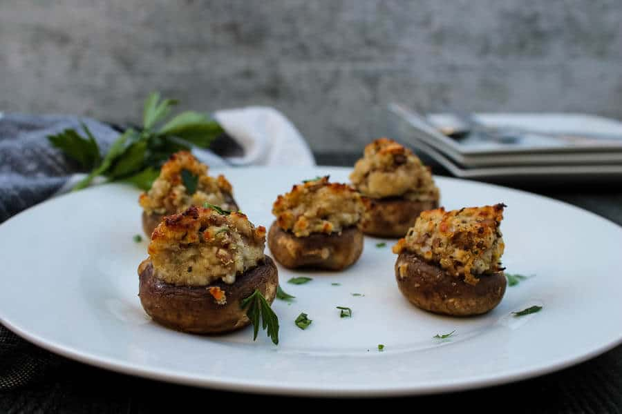 These Cheese-Stuffed Mushrooms are a long-time family favorite. Mushrooms are sauteed and then stuffed with Parmesan cheese, breadcrumbs, mushrooms and onions for a hearty, flavorful vegetarian appetizer that everyone will enjoy.