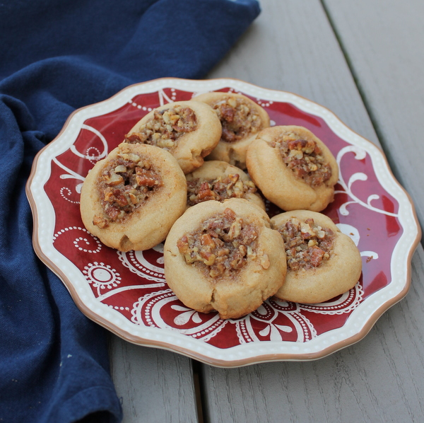 Pecan Pie Cookies feature a sweet shortbread cookie topped with classic pecan pie flavors.
