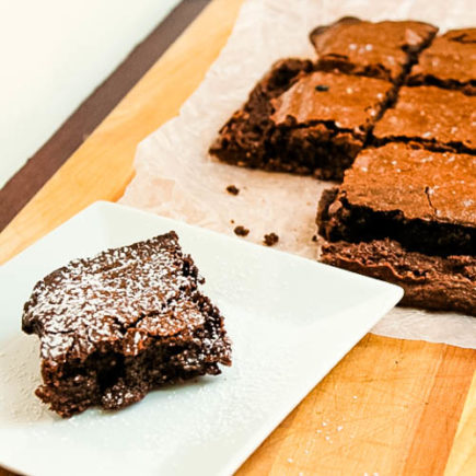 These gluten-free, fudge-like brownies are rich in chocolate flavor and sure to satisfy your sweet tooth!