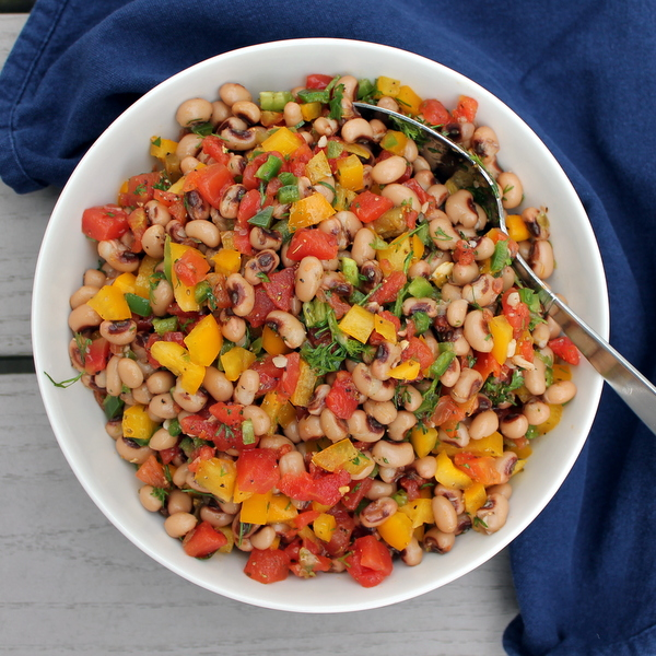 Black eyed peas and fresh veggies are combined to make a hearty, filling – and still healthy! – appetizer perfect for your next Game Day.