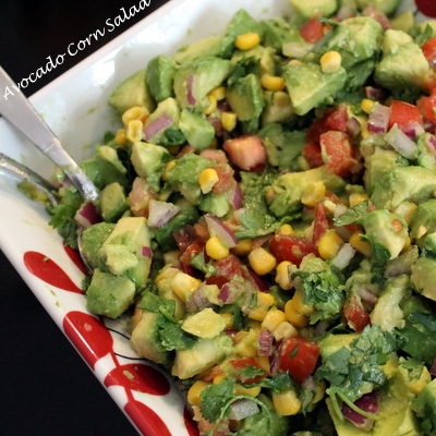 Avocado Corn Salad - Fresh, ripe summer veggies - avocado, corn, and tomatoes - are tossed with fresh herbs, a little jalapeno, and vinaigrette makings to create a summer side dish or poolside munchie that's simply irresistible. My favorite way to serve it? As a dip with tortilla chips!