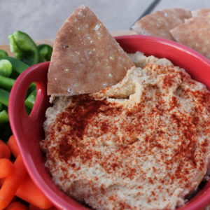 With a slight kick from fresh garlic, homemade hummus is an easy, healthy munchie for snack or entertaining. Pair it with veggies, pitas, or pretzel chips for an irresistible snack.
