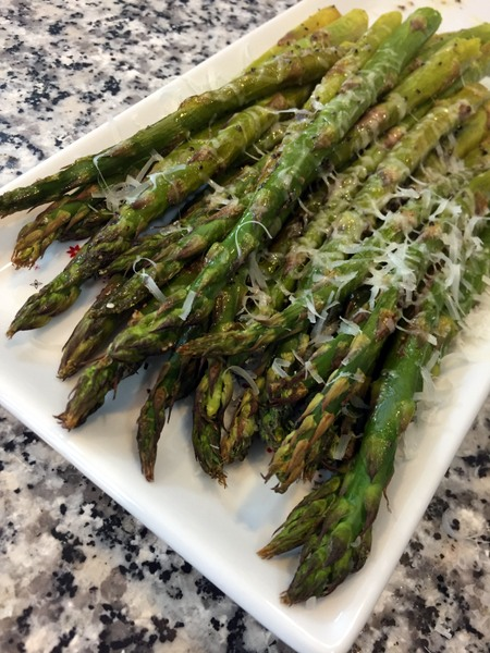 Simple roasted asparagus topped with a generous sprinkle of freshly shaved Parmesan cheese - it's a side that's delicious for brunch, lunch, or dinner.