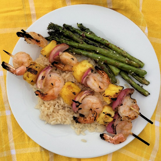 Shrimp and pineapple kabobs are brushed with a sweet and spicy BBQ sauce for a quick and flavorful weeknight meal.