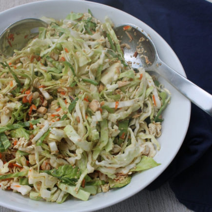 This Crunchy Asian Salad gets its amazing crunch from crisp veggies, slivered almonds and ramen noodles. Tossed with a lightly sweet dressing, it makes for a fun and bright lunch.