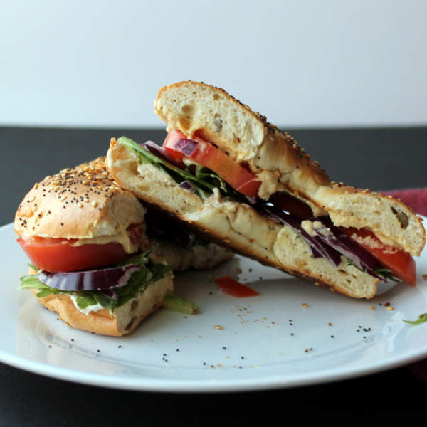 Veggie Bagel Sandwich - Veggie Bagel Sandwich - Crisp garden vegetables, protein-packed hummus and cream cheese, and a savory bagel come together in a make-at-home version of my favorite bagel sandwich from a popular bagel chain.