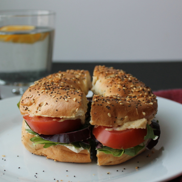 Veggie Bagel Sandwich: Crisp garden vegetables, protein-packed hummus and cream cheese, and a savory bagel come together in a make-at-home version of my favorite bagel sandwich from a popular bagel chain.