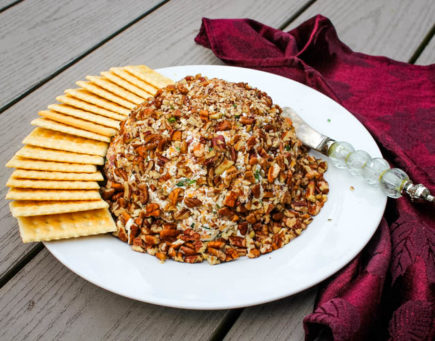 Salty bacon, zesty ranch and crunchy pecans make this Bacon Cheddar Ranch Cheeseball a hit.