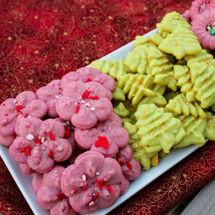 Classic Spritz are buttery, melt-in-your-mouth almond cookies - created in bright colors and topped with sprinkles - that are popular around Christmastime. These little cookies bring a fun bit of holiday cheer to lunchboxes, afternoon snacks or holiday dessert tables.