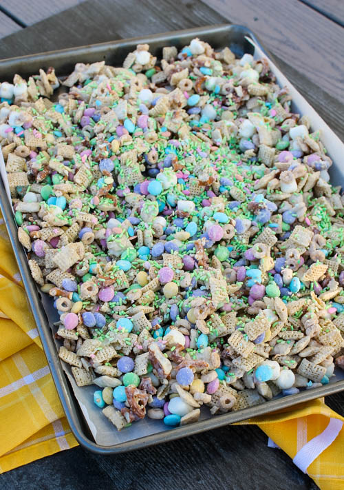 Chex cereal, Cheerios and pretzels are tossed with kids' favorites (M&Ms and marshmallows!) and covered with a vanilla candy coating and springtime sprinkles to create this Cottontail Chex Mix, a festive snack that's hard to stop at just one handful.