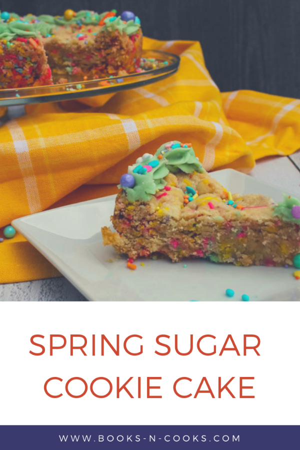 This Spring Sugar Cookie Cake is an easy sweet treat to bring a smile to faces this spring. Rich in vanilla flavor and topped with a bit of spring-colored frosting and festive sprinkles, this Spring Sugar Cookie Cake is simply irresistible.