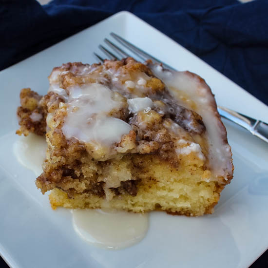 This Cinnamon Roll Cake is a light, fluffy cake swirled with rich cinnamon, reminiscent of one of my favorite breakfast pastries.