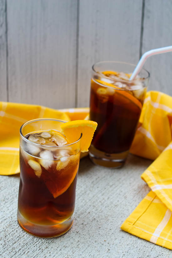 Unsweetened black tea is chilled and sweetened with Pimm's liquor and a little agave. With a splash of lemon juice and a wedge of your favorite citrus, this Pimm's Iced Tea is a sweet cocktail lovely for brunch or a warm afternoon sitting on the porch.