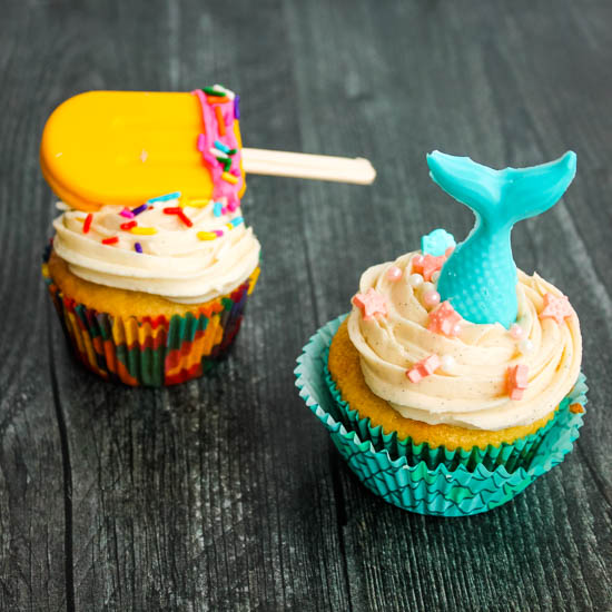 Cupcakes rich in vanilla flavor get a little bit of summer flair with candy mermaids and popsicles. Get the recipe for Vanilla Cupcakes with Vanilla Buttercream Frosting AND learn my secret to these easy and impressive decorations.