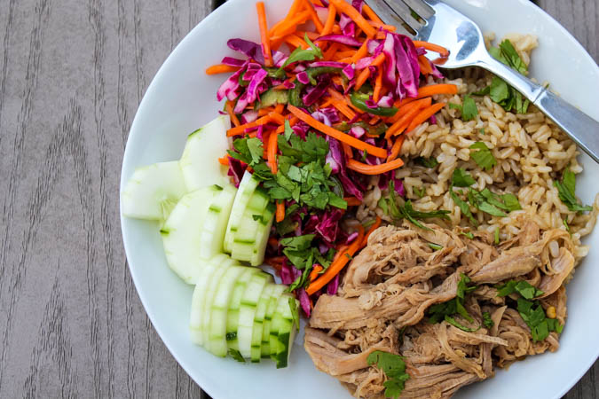 Sweet yet spicy pulled pork, quick pickled vegetables and hearty brown rice is my new favorite summer combo - Slow Cooker Pork Banh Mi Bowls with Pickled Vegetables. With bright flavors, you don't even need to turn on the oven to enjoy this satisfying meal!