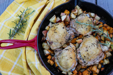 Apples, sweet potato and chicken thighs simmer away with fall rosemary and apple cider tea for a healthy, flavorful fall dinner.