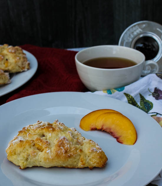 Light and fluffy with sweet fresh peaches, these Peach Scones are a wonderful snack to accompany an afternoon cup of tea.