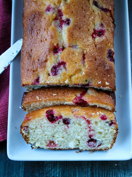 This easy loaf cake is full of bright flavors, thanks to tart cranberries and lemons. Topped with a sweet lemon glaze, this Lemon-Cranberry Cake will be a welcomed addition to any fall dessert table... or afternoon snack.