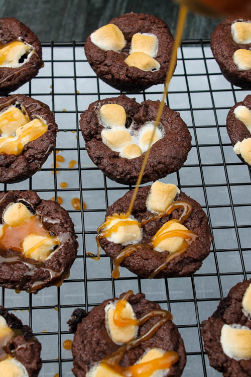 These Kahlua Hot Chocolate Cookies are a rich, decadent bite for your holiday dessert table. A soft pillow of chocolate, with a touch of Kahlua, topped with marshmallows and a caramel drizzle, what's not to love?