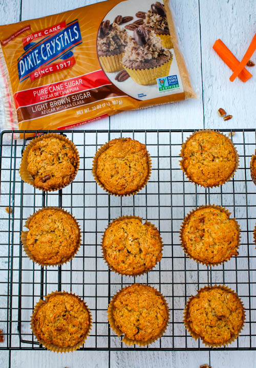 Celebrate spring and carrot cake season with these Carrot Cake Muffins - Any muffin that tastes like a dessert is a Breakfast Win in my book and as an added bonus, get in some veggies before lunch!