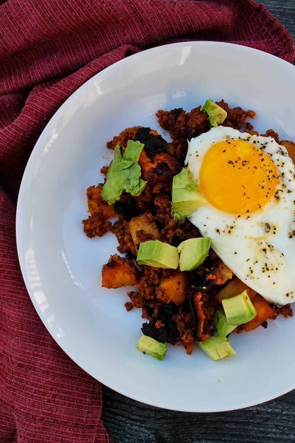 Chorizo Potato Hash is a tasty, indulgent dish of sauteed potatoes and Mexican chorizo, topped with a fried egg and fresh avocado. Enjoy as a hearty breakfast, flavorful brunch, or comforting breakfast for dinner.